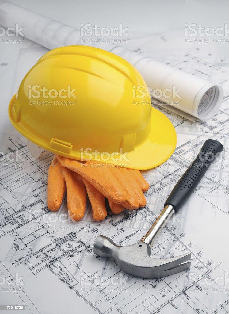 Blueprints and Yellow Helmet royalty-free stock photo