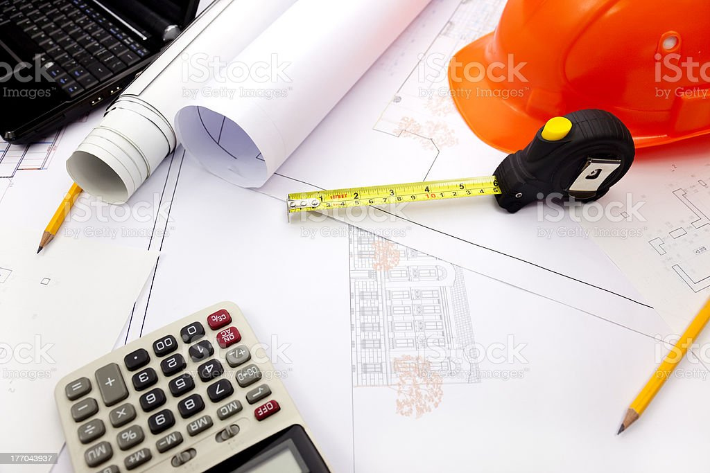 Blueprints background with computer and tools royalty-free stock photo