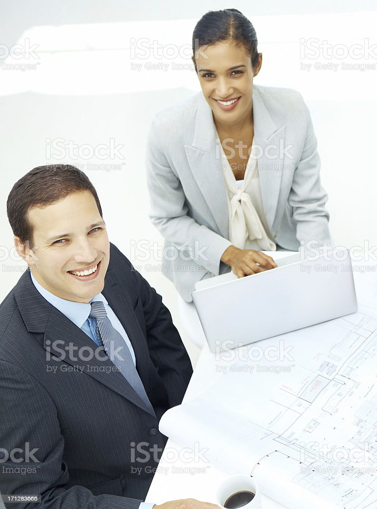 Blueprints to success - Teamwork royalty-free stock photo