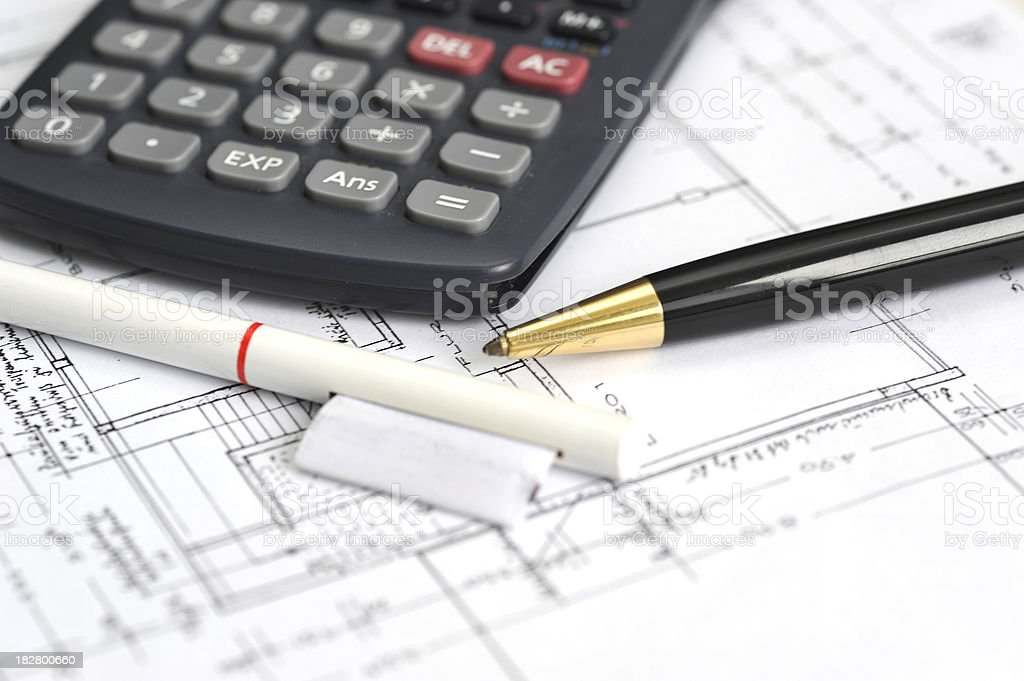 blueprints with calculator and pens stock photo