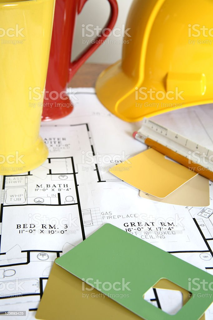 Blueprints with paint samples and hardhat royalty-free stock photo