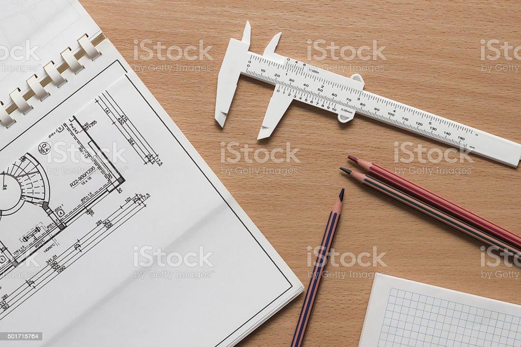 Blueprint,vernier scale,pencils,paper on wooden table stock photo