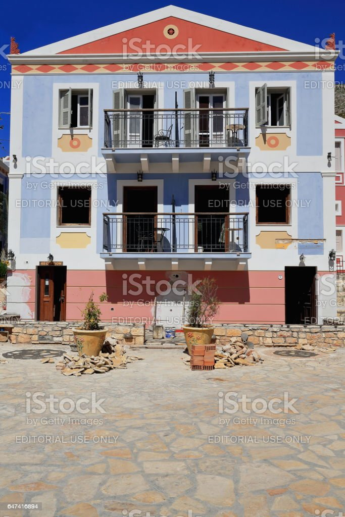 Blue-red-pink neoclassical house in restoration. Pera Meria district-Kastellorizo-Greece. 1581 stock photo