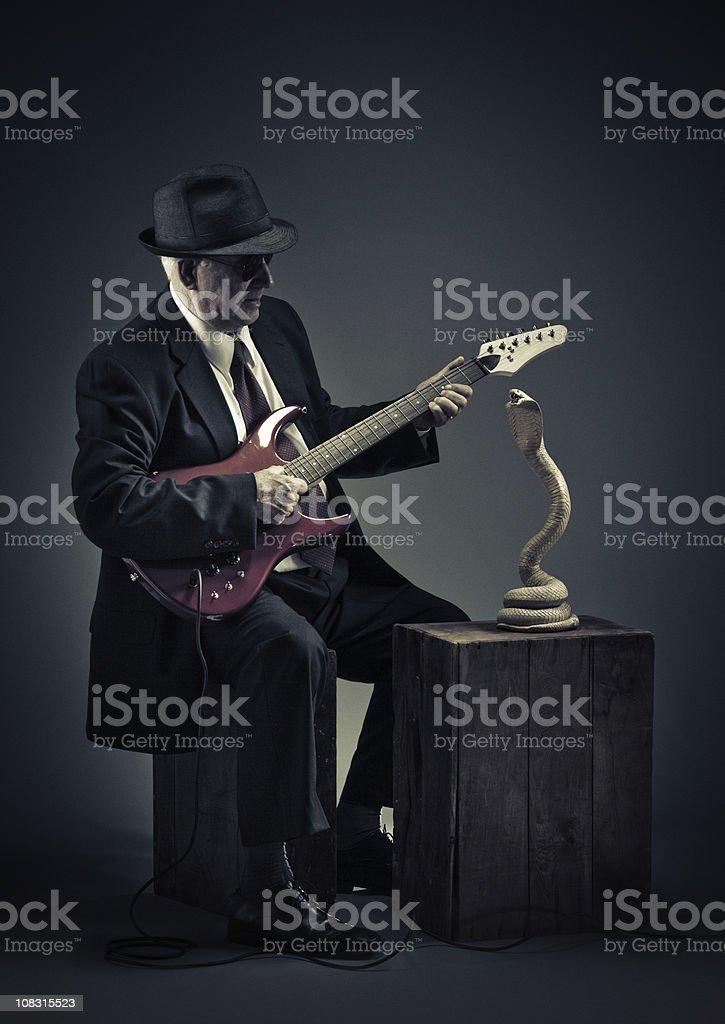 blues snake charmer stock photo