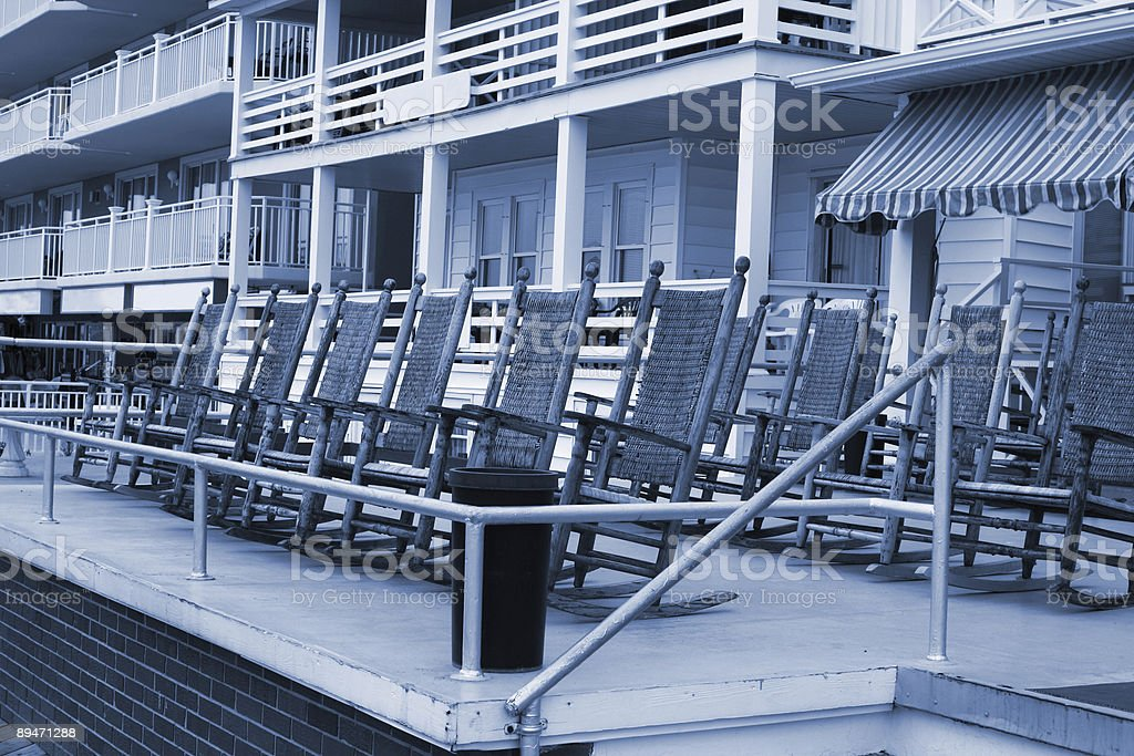 Blue-Tinted Beach Rocking Chairs stock photo