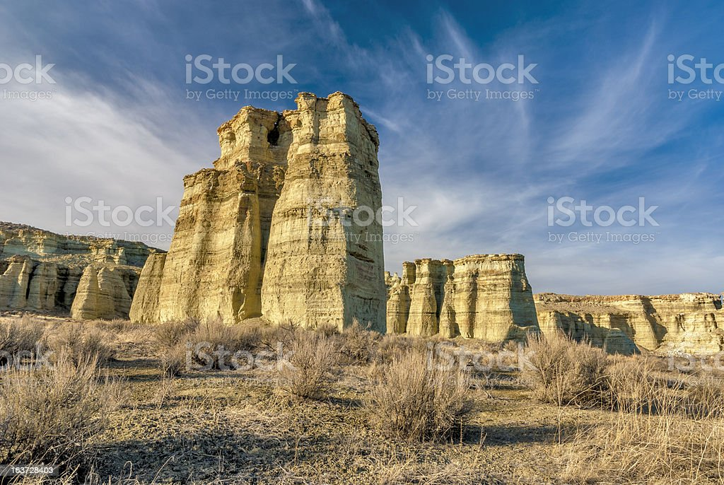 Bluffs in the wild west under a blue sky royalty-free stock photo
