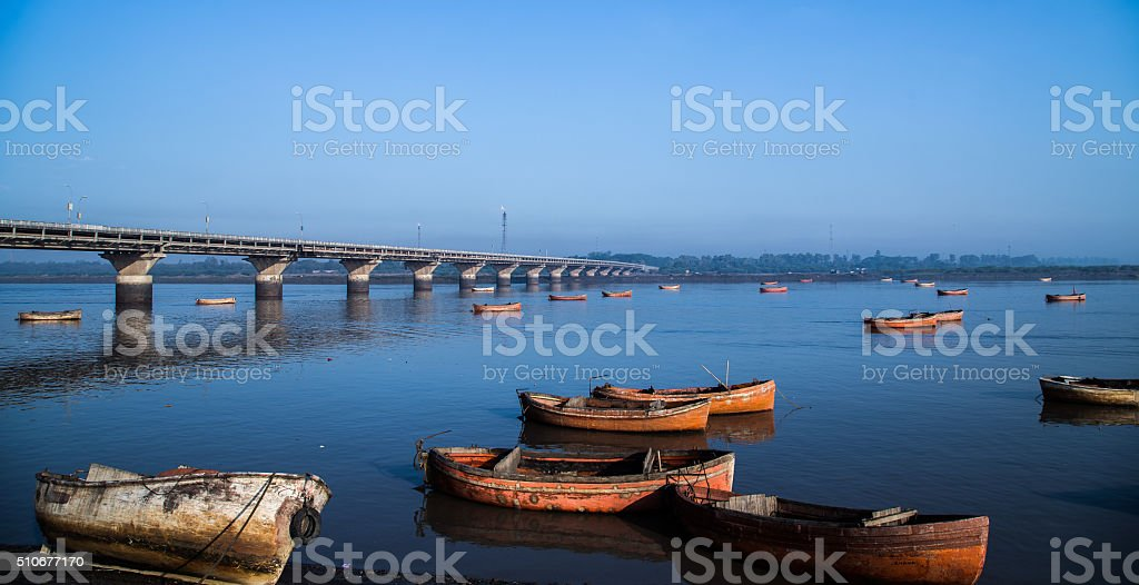 Bluish Tapi Riverscape with Indian Boats and Bridge stock photo
