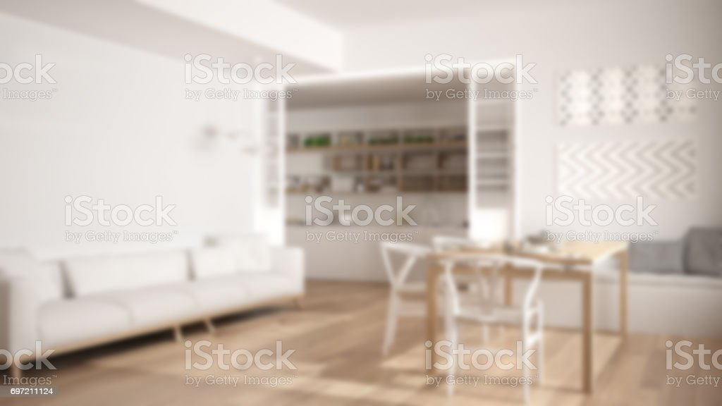 Blur background interior design, minimalist kitchen and living room with sofa, table and chairs stock photo