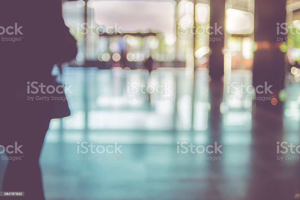 Blur background,people walking at corridor in convention hall, o stock photo