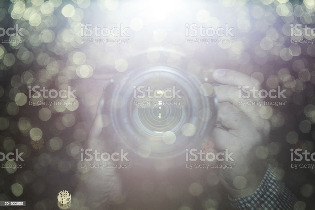 blur background,Reflection of hand holding camera stock photo