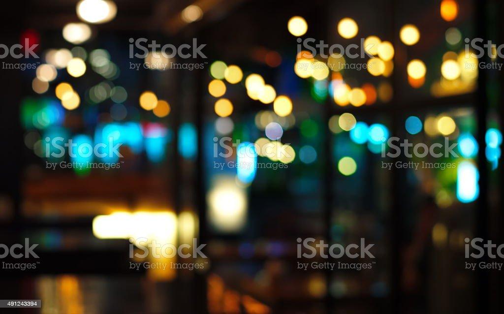 blur blue light in pub at night stock photo