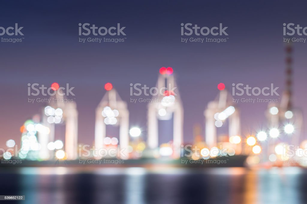 Blur bokeh of harbor with Container Cargo freight ship. stock photo