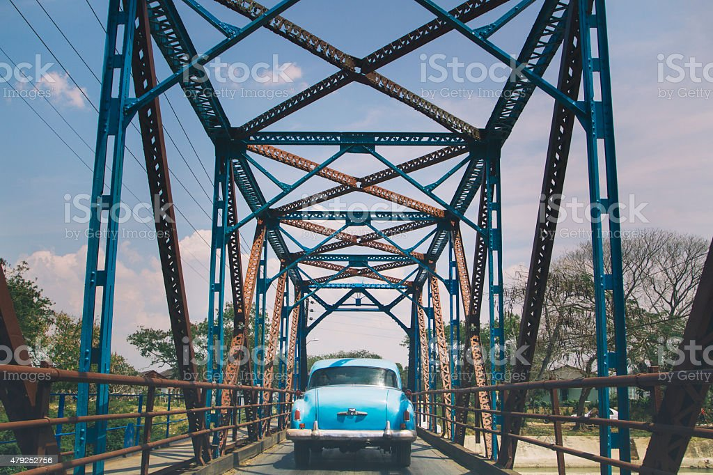 Blur car on a blue bridge, Cuba stock photo