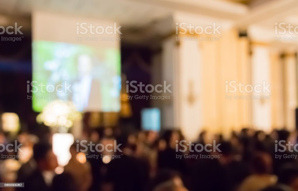 blur  clouded customers  in hotel ballroom and monitor at night stock photo
