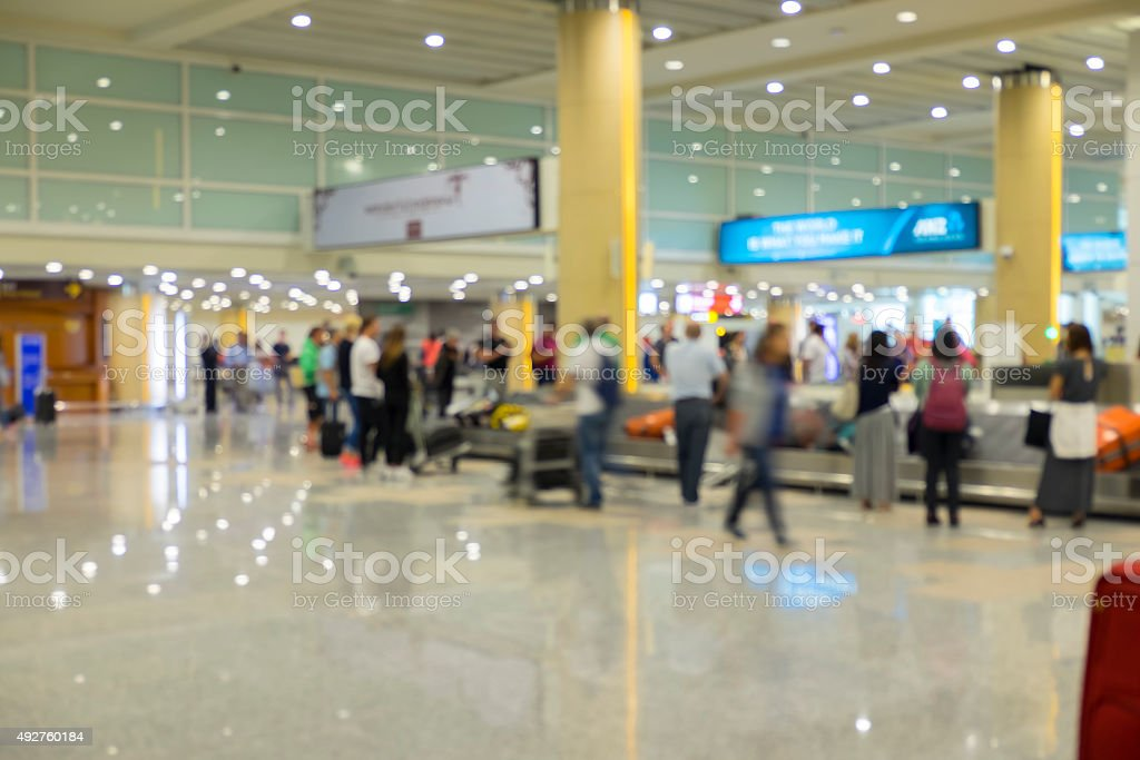 Blur focus of people waiting luggage at Baggage claim. stock photo