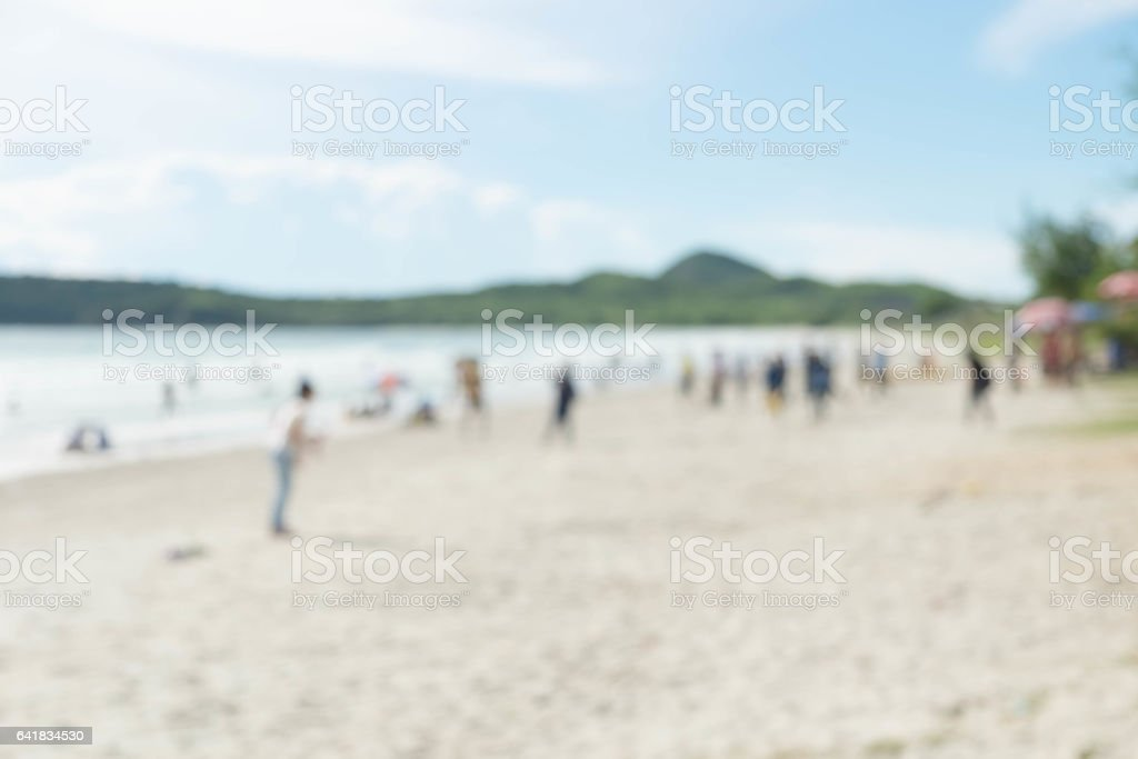 Blur group of people are doing activity on the beach stock photo
