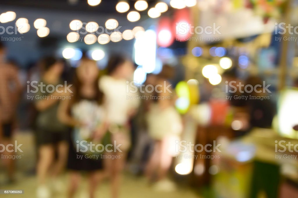 blur image food at night festival with bokeh background. stock photo