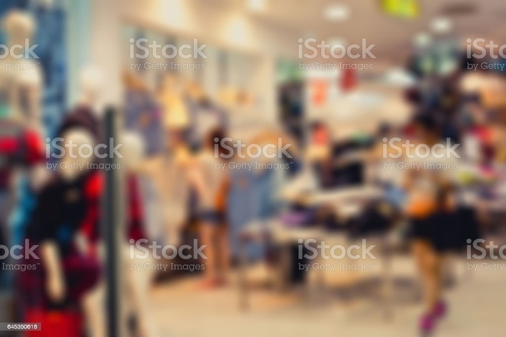 Blur image of a dress store with customers. stock photo