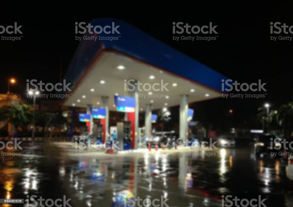 Blur image of gas station at night.Abstract blur petrol station background out of focus stock photo