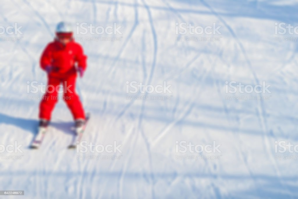 Blur image of Little girl learning downhill alpine skiing.  . Concepts Christmas, sport, healthy lifestyle, winter fun. Background, place tex stock photo