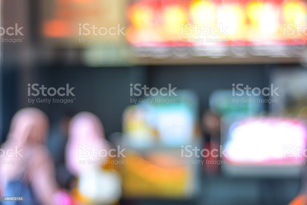 Blur image of people queue for popcorn before watching cinema. stock photo