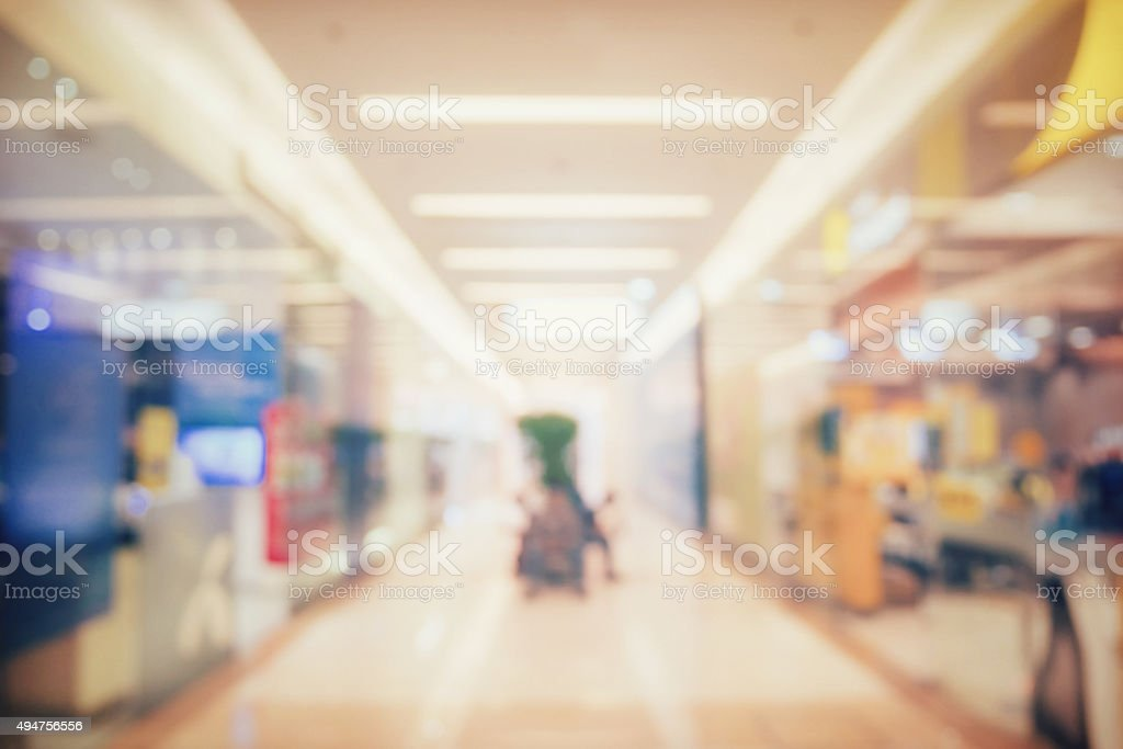 blur image of people shopping in department store stock photo