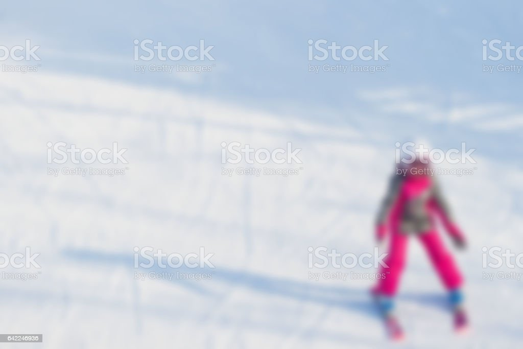 Blur image of teenage girl learning on equipped for skiing  snowy slope at ski resort.  . Concepts Christmas, sport, healthy lifestyle, winter fun. Background, place te stock photo