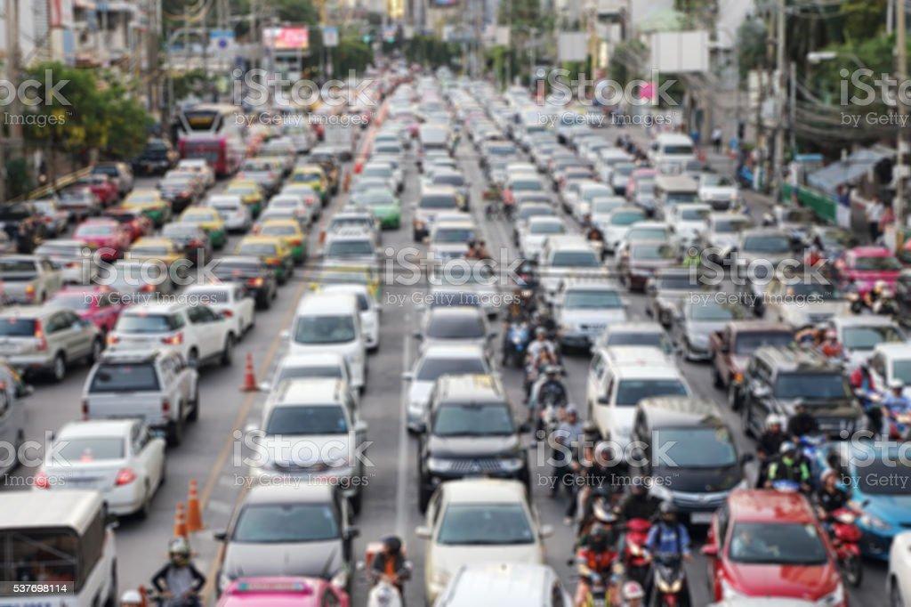 blur image of traffic jam at asoke intersection stock photo