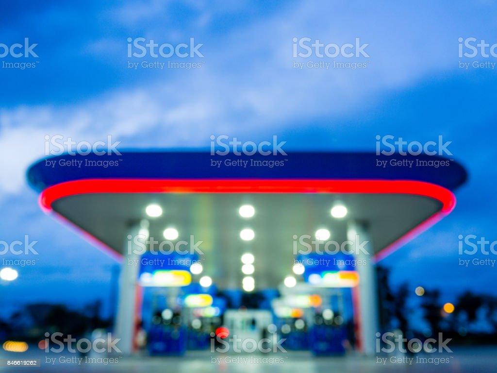 Blur image of twilight gas station during sunset. stock photo