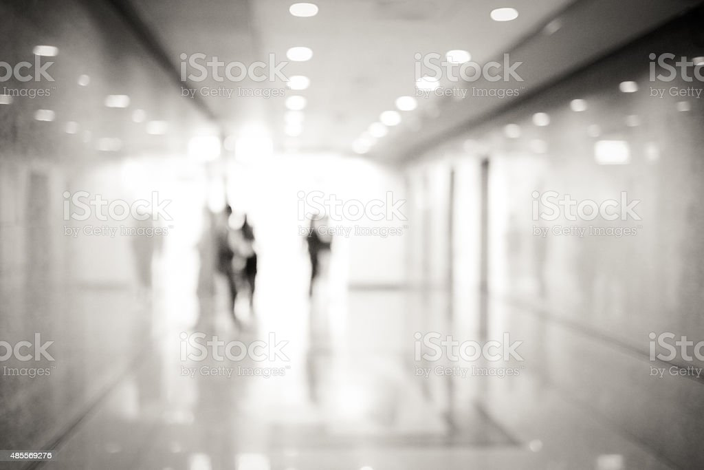Blur inside office building with people and bokeh light stock photo