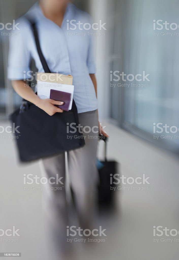 Blur motion of an airline passenger with a trolley bag royalty-free stock photo
