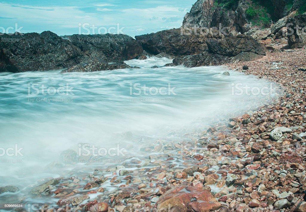 Blur motion, Waves wash ashore during stock photo