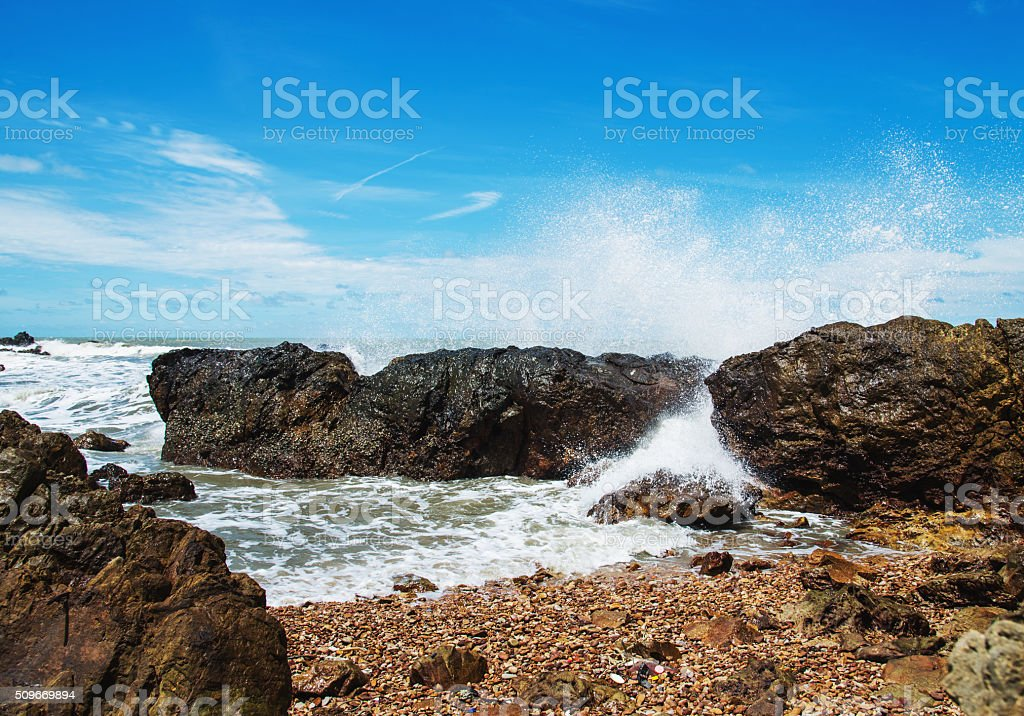 Blur motion, Waves wash ashore during with rock stock photo