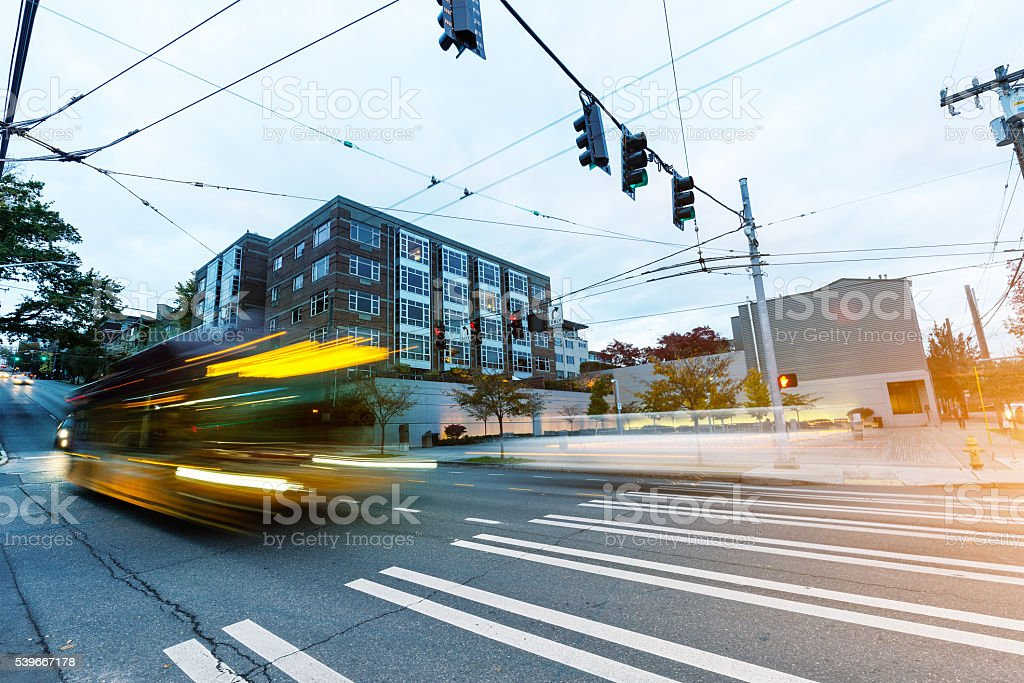 blur moving bus at road intersection in seattle stock photo