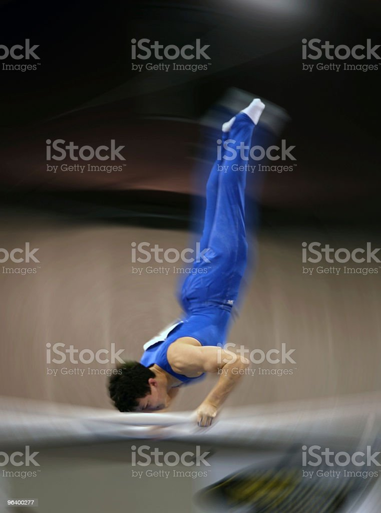 Blur of a gymnast on parallel bar royalty-free stock photo
