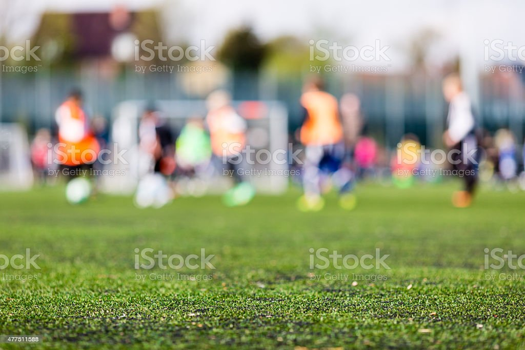 Blur of young boys playing soccer match stock photo