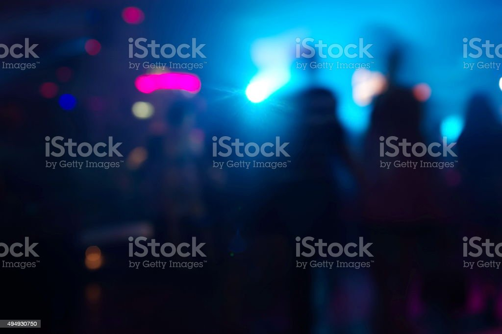blur people at party in pub at night stock photo