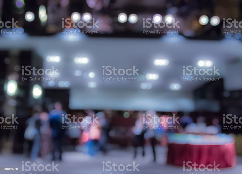 Blur people eating and talking in dining room  at night stock photo