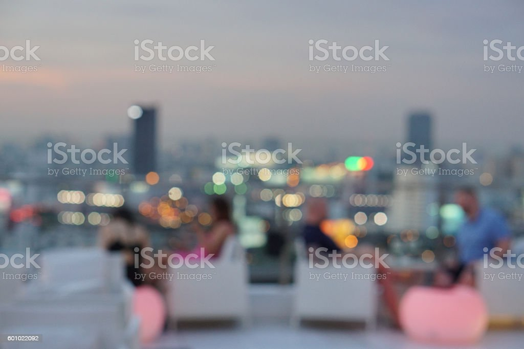 blur photo of people at  luxury rooftop bar stock photo