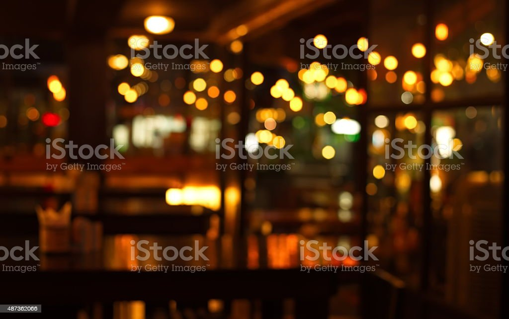 blur pub and restaurant at night stock photo