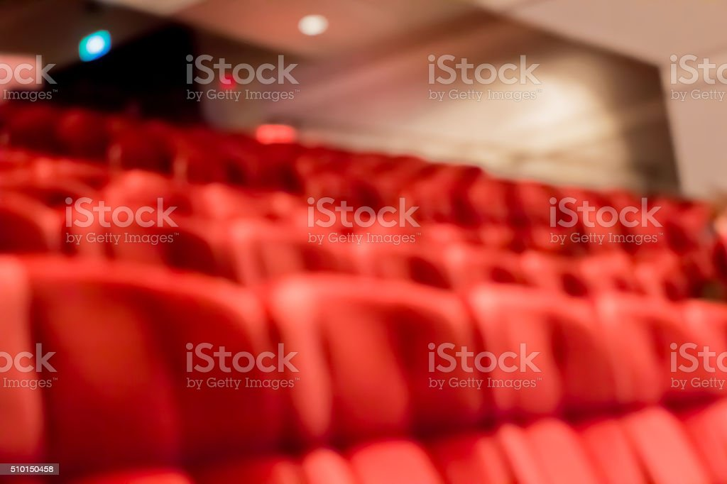 blur row of  empty red auditorium or theater seat stock photo