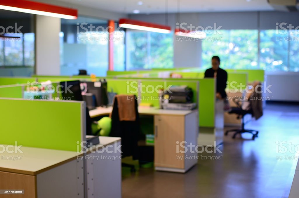 Blur scene of girl working alone at the office stock photo