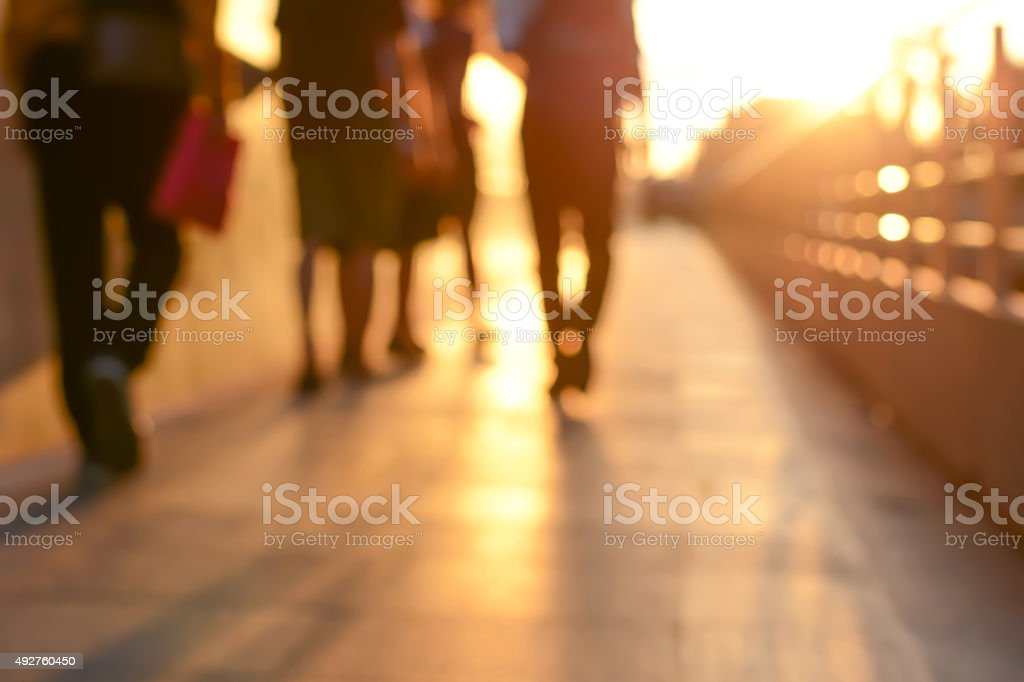 Blur silhouette of people walking on walkway in twilight stock photo