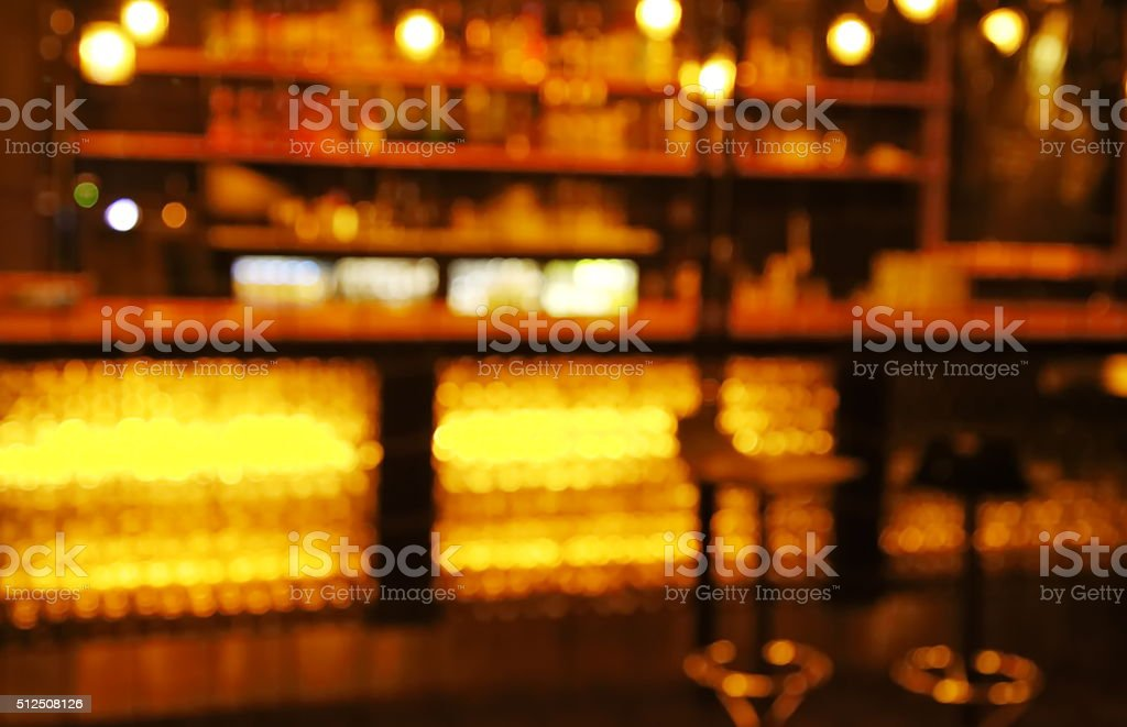 blur stools at counter in  bar  at dark night stock photo