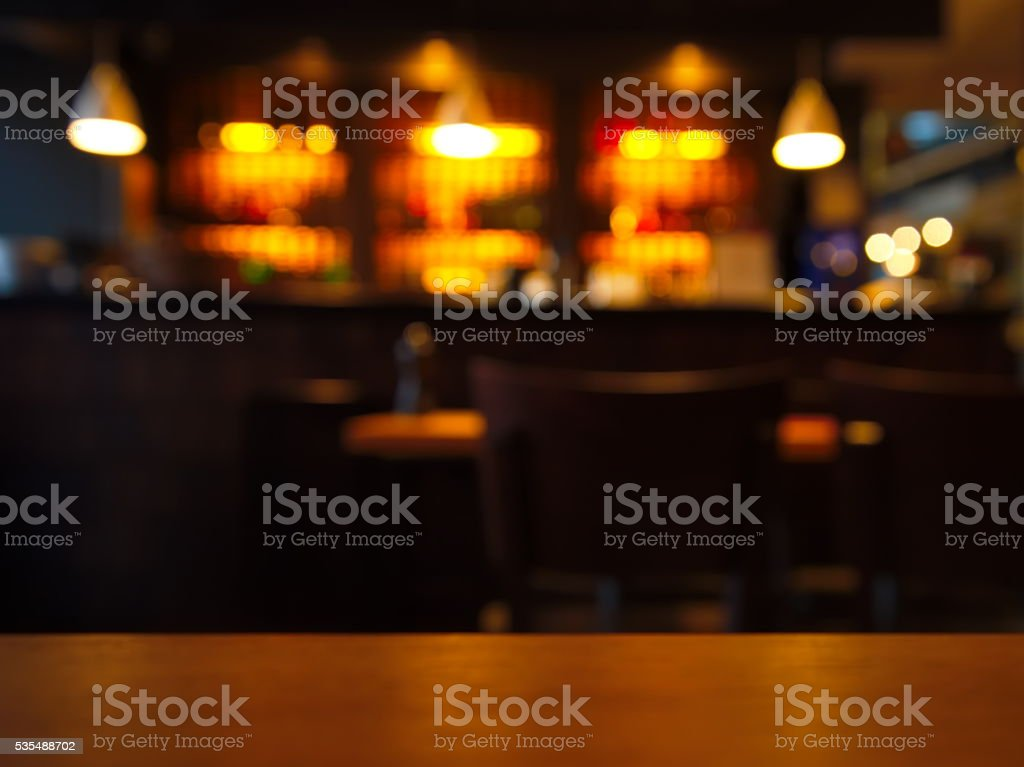 blur table top with night club at night background