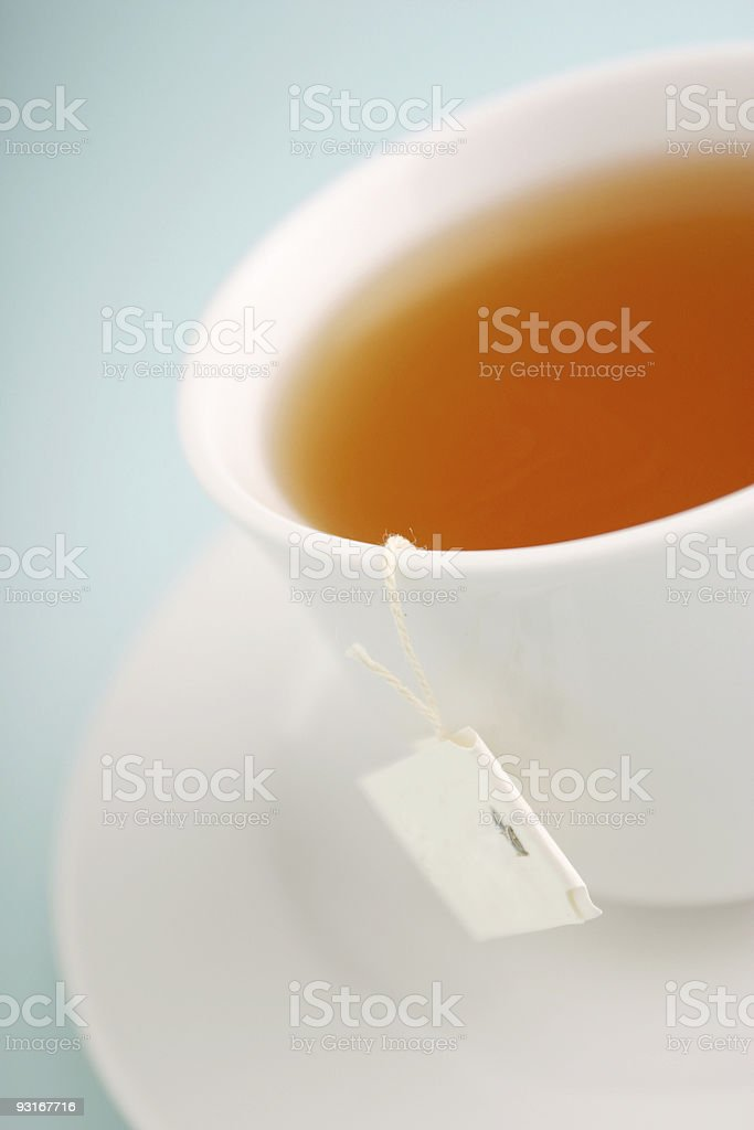 Blur white cup of tea in a light blue background royalty-free stock photo