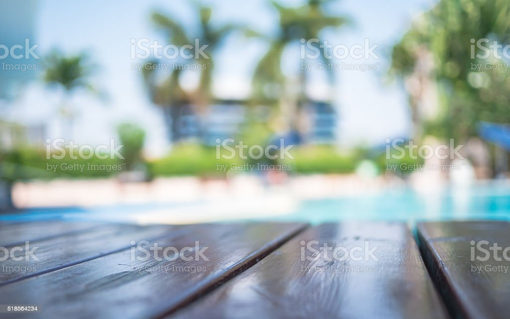 Blur wooden table on pool background, stock photo