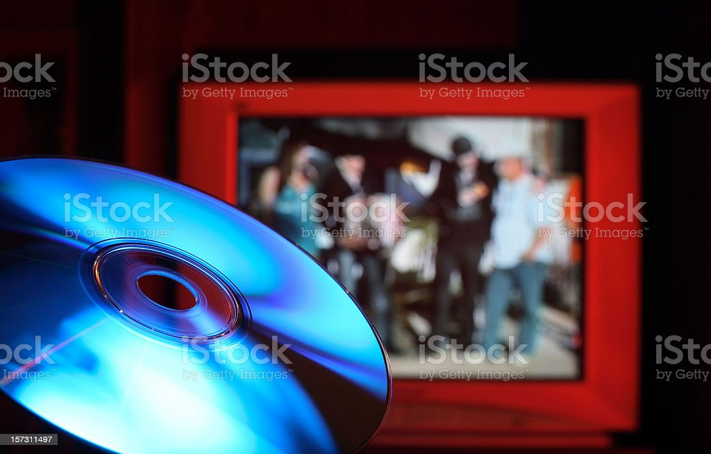 Blu-Ray DVD Disc Against Red TV royalty-free stock photo