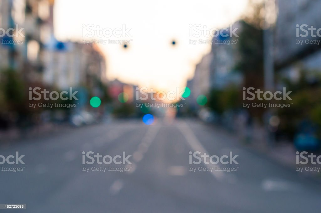 Blured empty evening street at the city. Urban background stock photo
