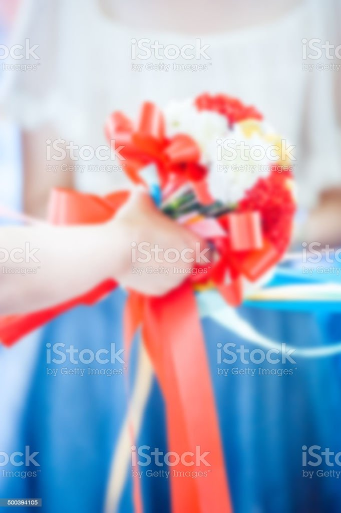 Blured flower in the hand of a bride vintage color royalty-free stock photo